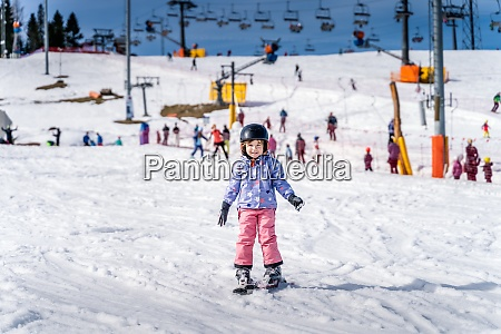 young skier girl learning how to