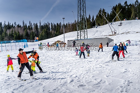 groups of skiers kids and adults