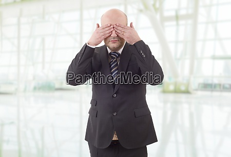 covering his eyes