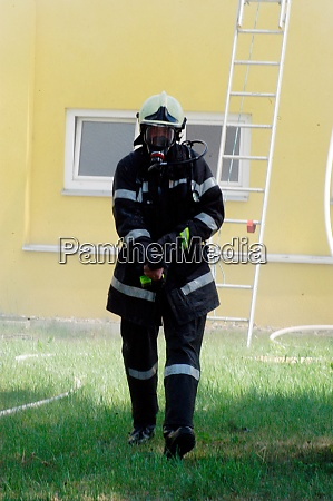 firefighter wearing protective clothing and respirator