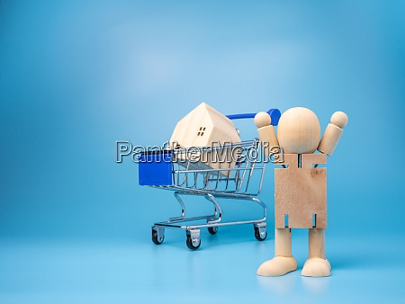 wooden dolls that stand next to