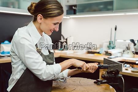 jewelry designer woman in her workshop
