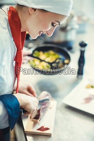 chef cook in fancy restaurant kitchen
