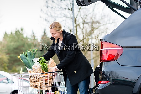 woman loading groceries after shopping into