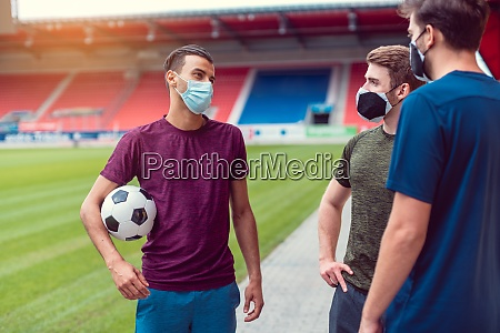 soccer players in football stadium during