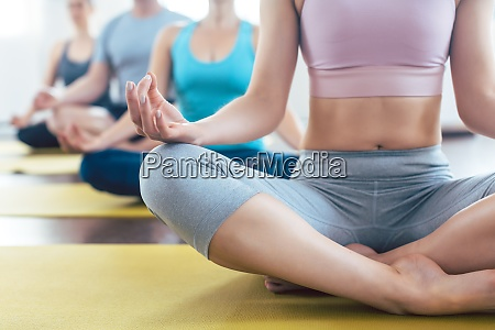 people meditating during yoga in easy