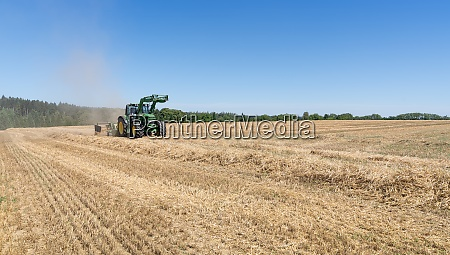 tractor with hay rake on a