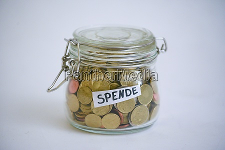 jar with coins saying spende donation