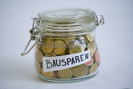 jar with coins saying bausparen building