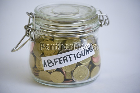 jar with coins saying abfertigung financial