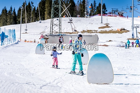 young happy skier girl learning how