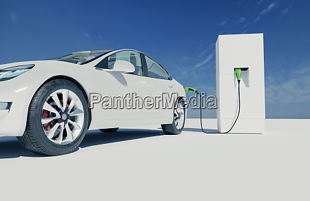 white electric car charges at a