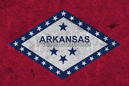flag of arkansas on weathered concrete