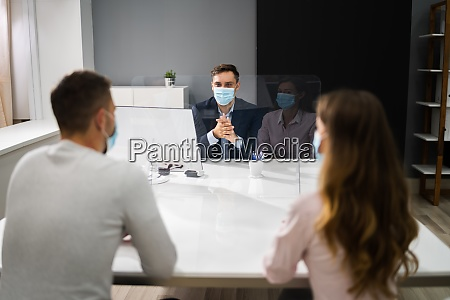 young family couple meeting consultant or