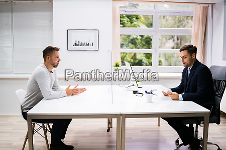 young man meeting consultant or lawyer