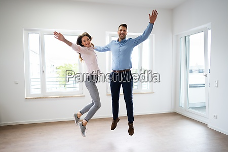 happy family jumping moving
