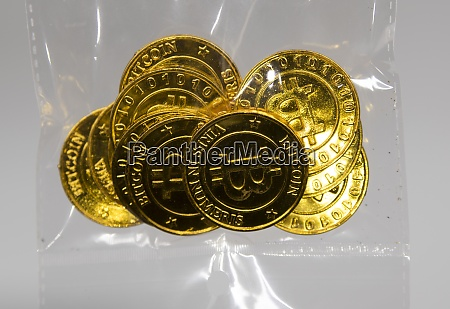 golden bitcoin coin representing the electronic
