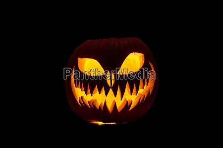 carved halloween pumpkin with candle