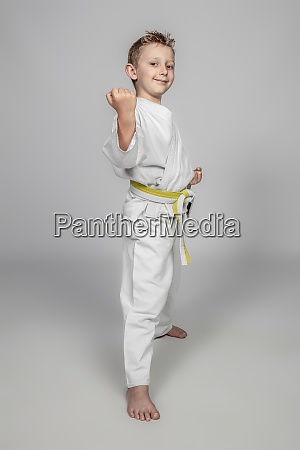 smiling child practicing martial arts