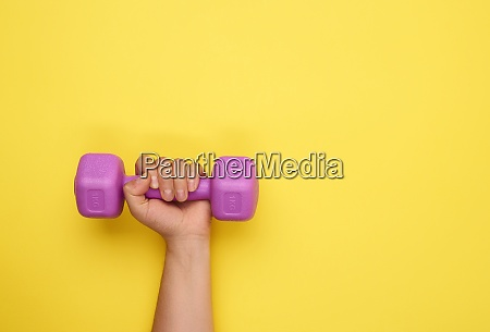 female hand holds a purple one