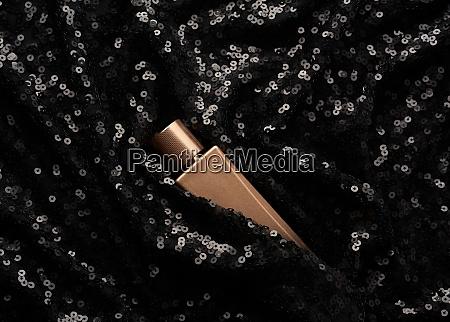 glass golden bottle of perfume on