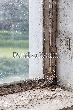 old and dusty window with spiderwebs