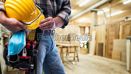 carpenter with work tools and surgical