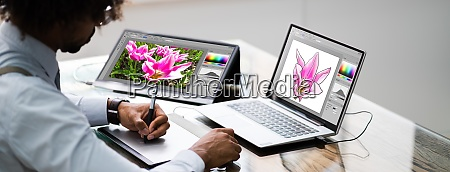 african american designer using laptop computer