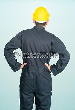 man in coveralls helmet hardhat