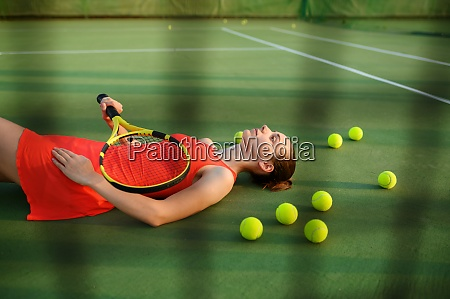 tired female tennis player lies on