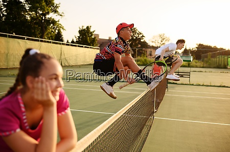 mixed doubles tennis players jump through