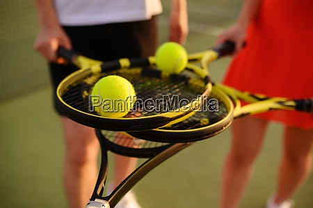 mixed tennis players with rackets and
