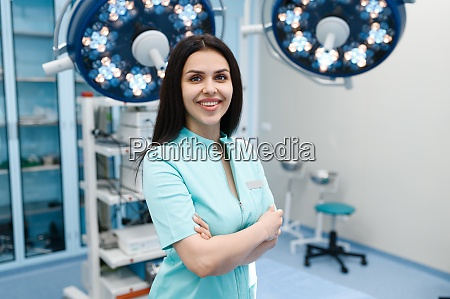 smiling female surgeon in operating room