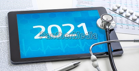 a tablet with the number 2021