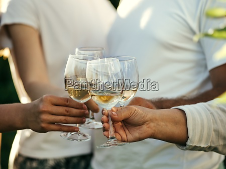 wine glasses in hands
