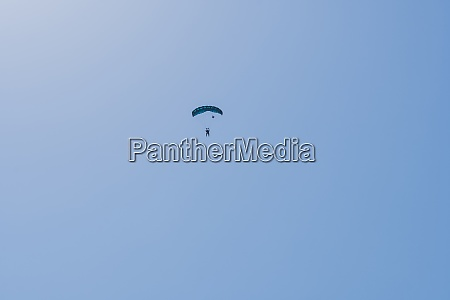 tandem parachute jump silhouette of skydiver