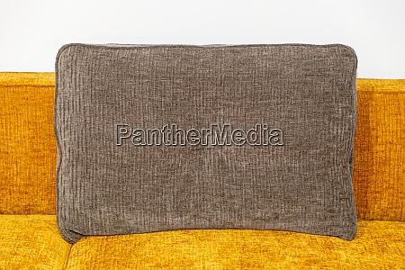 brown textile pillow
