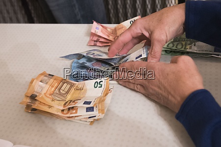 euro bank notes paying in the
