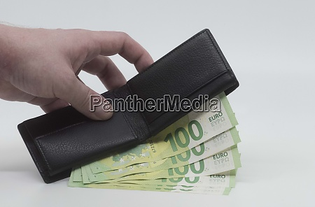 a wallet with euro bills