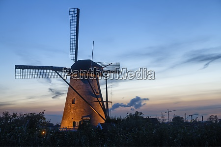 illuminated windmill at kinderdijk the netherlands