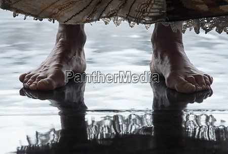 barefoot on a reflecting floor