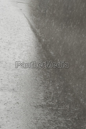heavy rain and rain puddles