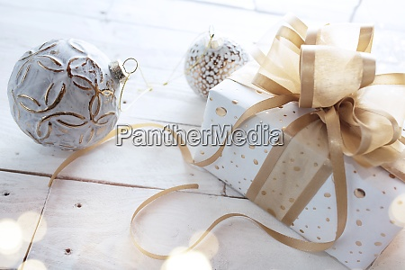 christmas gift with golden ribbon bow