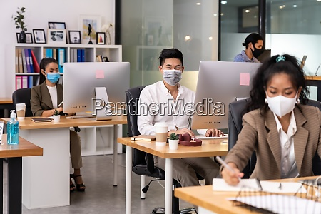 african office worker with asian team