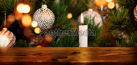 decorated christmas tree with wooden table