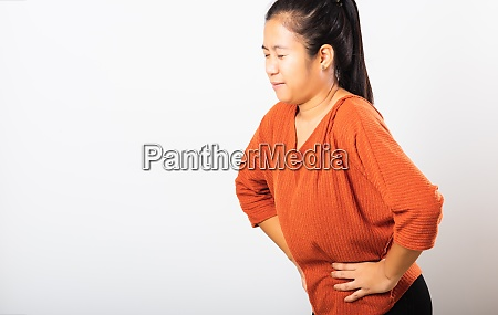 woman have stomach ache holds hands
