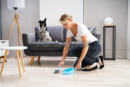 woman cleaning home living room floor