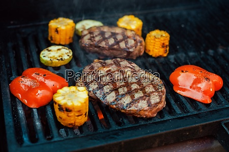 beef steaks on the grill with