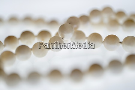 close up of pearl necklace on