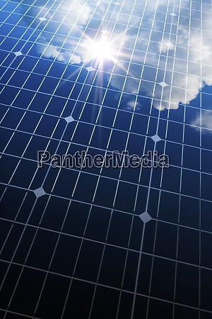 sun and clouds reflecting in solar